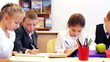 Attractive young pupils studying in the classroom