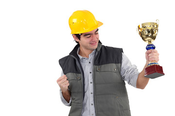Excited builder holding trophy