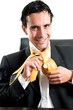 Relaxed smiling man at office making a tie knot