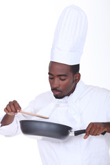 Chef checking sauce
