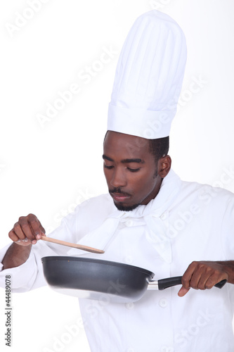 Chef checking sauce