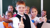 Group of successful schoolchildren showing thumb up together poster