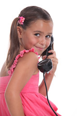Girl with old telephone handset