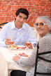 Grandmother and grandson at restaurant