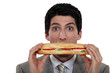 A man holding a sandwich.