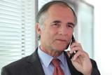 Senior businessman negotiating over the phone