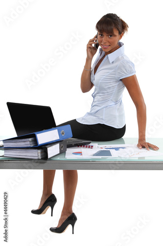 Woman sitting on the table in the office