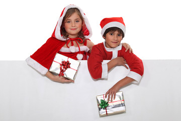 Festive children with a blank board