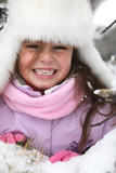 Happy little girl at ski resort