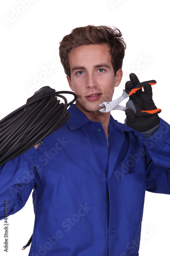 Electrician with a pair of wirecutters