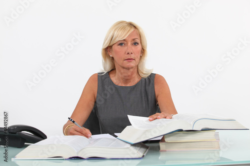 Mature businesswoman at a desk