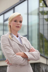Confident blond businesswoman outdoors