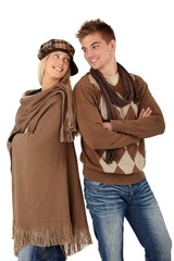 Portrait of happy couple in warm clothes