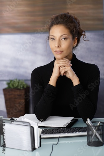 Portrait of attractive businesswoman at desk