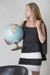 Young woman holding a terrestrial globe