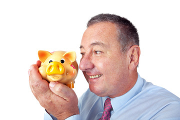 Businessman is pleased with his piggy bank