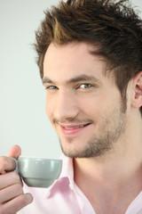Man holding small coffee