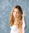 Beautiful blond angel with snowflakes