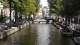 Amsterdam canal with bridge, in the historical centre