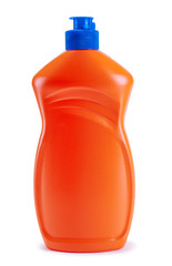 A bottle of orange with detergent