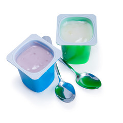 two plastic cups with yogurt and spoon