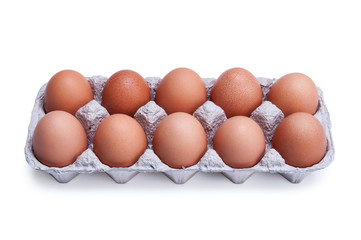 Ten brown eggs in a box