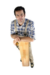 Worried builder with planks of wood