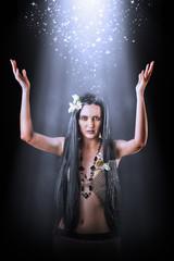 Beautiful asian woman witch making magic