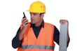 craftsman talking on his walkie-talkie
