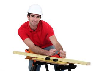 Man planing wood