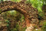 Ancient roman Balkan fortress arch gate ruins in forest poster