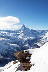 Winter landscape with Matterhorm mountain and stone