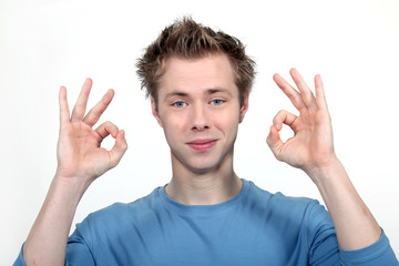 Young man making a double OK sign