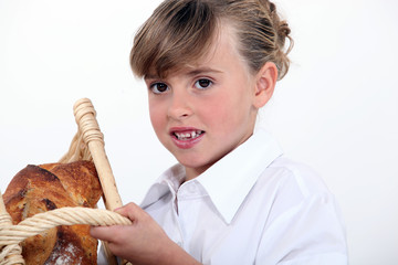 Girl with a basket of bread