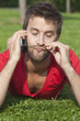 Young man thinking on the phone