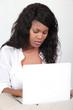 Black woman using laptop computer