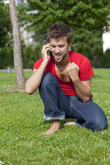 convincing young man talking on the phone