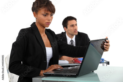 Woman disturbed by her laptop