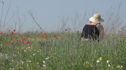 Lady in poppy field