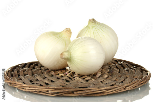 white onion on wicker mat isolated on white background