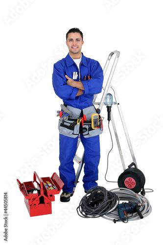 Confident electrician, studio shot