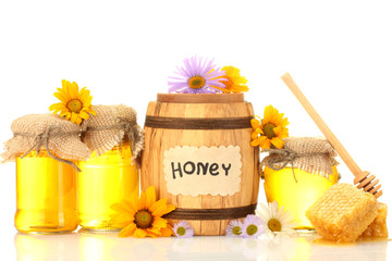 Sweet honey in jars and barrel with honeycomb, wooden drizzler