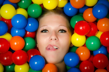 Woman with lip piercing and coloured balls