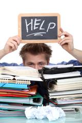 Student swamped under paperwork