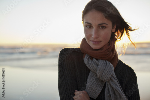 Portrait of serious woman on beach at sunset