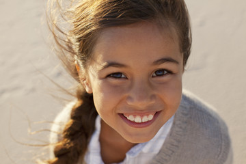 Portrait of smiling girl on beach