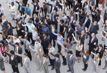 Crowd of waving business people