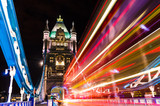 Fototapety Tower Bridge in London, UK with moving red double-decker bus