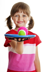 little girl playing a ball game isolated on a white background