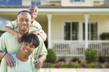 Attractive African American Family in Front of Home